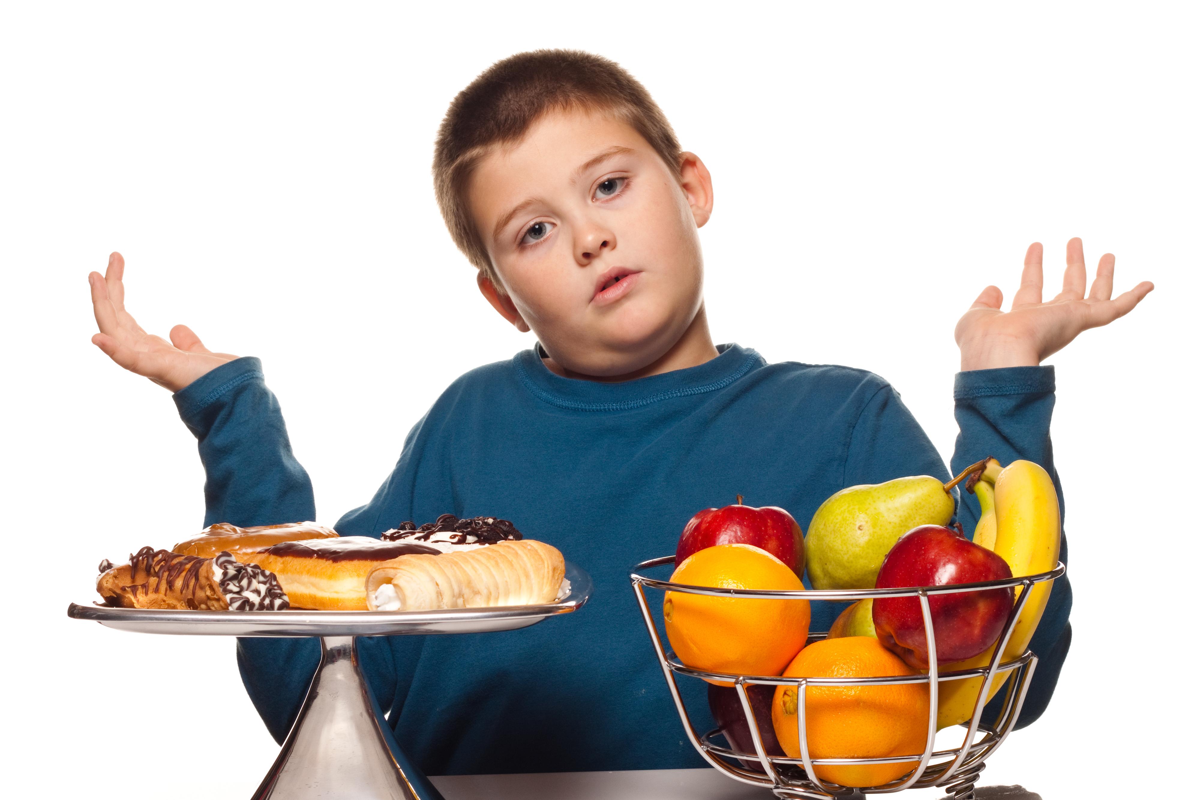 bigstock-A-Boy-s-Choice-Of-A-Healthy-Or-11030450