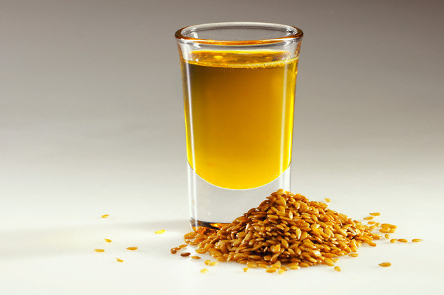 Flax Seeds and Cup of Flax Seed Oil